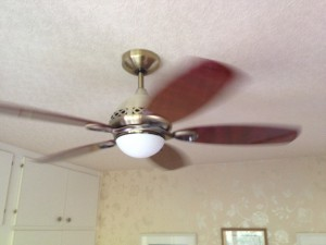 "A 42"" ceiling fan in a bedroom running at a medium speed"